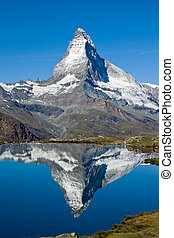 Doubled Matterhorn - The famous Matterhorn reflected in the...