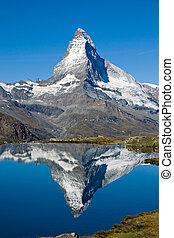 Doubled Matterhorn - The famous Matterhorn reflected in the...