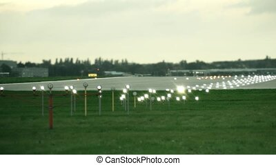 Lit airport runway in the evening - Airport runway in the...