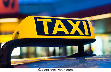 Taxi sign on the roof of a car