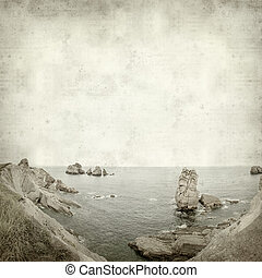 textured old paper background with Costa Quebrada, Cantabria