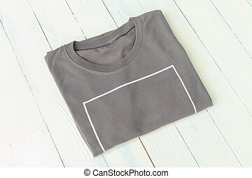 T-shirts put on white wooden table top background