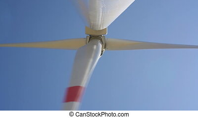Windmills converting wind energy into electricity in...
