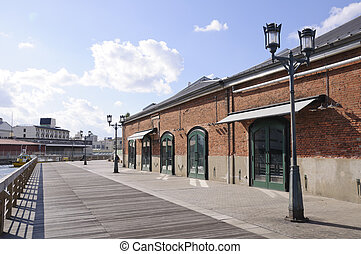 Kobe, Japan - Harborwalk and Red brick warehouse in Kobe,...