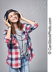 Teen girl listening enjoying music in headphones, music...