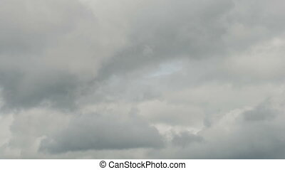 Fast-moving low dark clouds across the sky before heavy rain...
