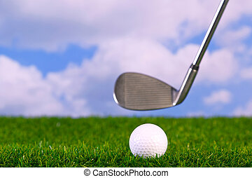Photo of a golf club hitting ball - Surface level photo of...