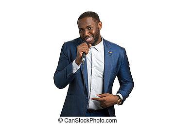 Smiling black man hold microphone. Elegant afro american man...