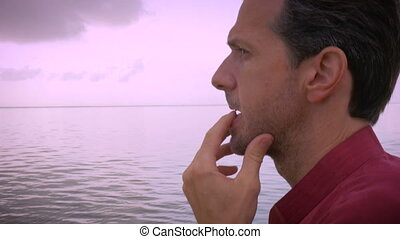 A middle aged man worries about his future and contemplates...