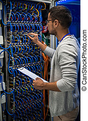 IT Professional Working with Servers - Back view portrait of...