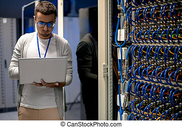Modern Network Engineer - Portrait of young man with laptop...