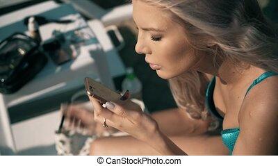 Close-up of a beautiful woman doing makeup