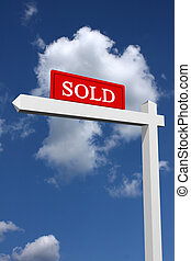 Sold sign - Real estate type sold sign with sky background