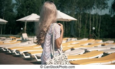 Beautiful woman lying on deck chair Young woman relaxes by...