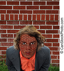 Brick Wall Surrealism - Young businessman looking upward...