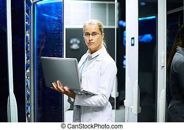 Female Scientist Posing with Supercomputer - Portrait of...