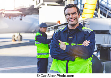 Outgoing man locating on airdrome - Portrait of cheerful...