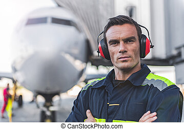 Serene man having job at airdrome - Portrait of serious male...