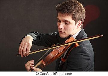Man man dressed elegantly playing violin - Music passion,...