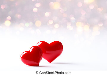 Two red hearts - Two Hearts over blured background with...