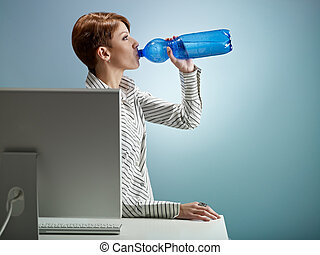 businesswoman drinking water - caucasian business woman...
