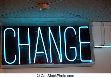 The word change lit up in an amusement arcade