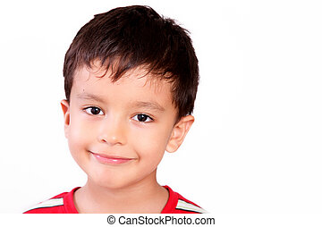 Looking - Happy boy looking at the camera with a small smile...