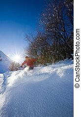 Freeride skier - Young male freeride skier goes down in...