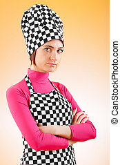 Young female cook against gradient background