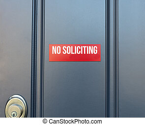 No soliciting red sign on residential front door of home