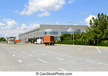 Warehouse parking - Big industrial warehouse with parking in...