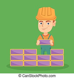 Caucasian bricklayer boy building a brick wall. - Little...