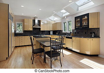 Kitchen with skylights - Kitchen in modern home with three...