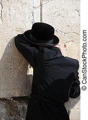 At the Wailing Wall - Orthodox Jewish worshiper at the...