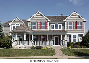 Home with front porch - Suburban home with cedar roof and...