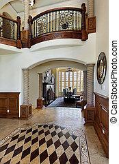 Foyer with floor design - Foyer in luxury home with floor...