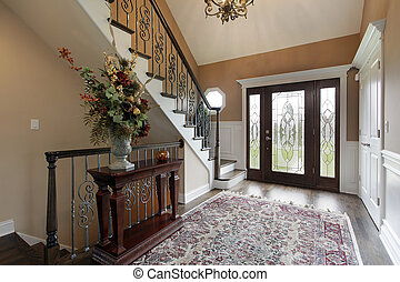 Foyer with leaded glass doors - Foyer in suburban home with...