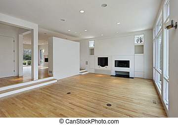 Family room with white cabinetry - Family room in remodeled...