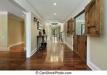 Long foyer with wooden barn doors