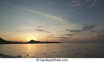 Sunrise at tropical Lamai Beach in Koh Samui Island,...