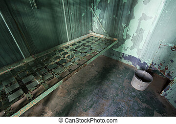 metal bed - ultrawide angle view of a metal prison bed.