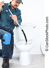 Plumber fixing a flush toilet