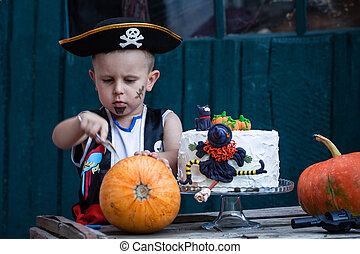 Pirate with a pumpkin and cake - A little pirate with a...