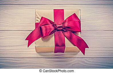 Wrapped present box on wooden board directly above holidays...