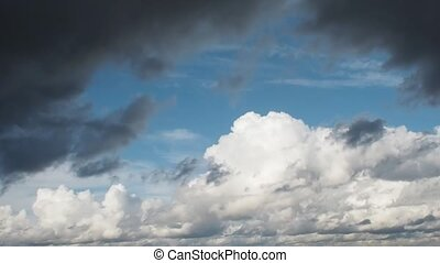Dark clouds cover the blue sky, beautiful clouds flying...
