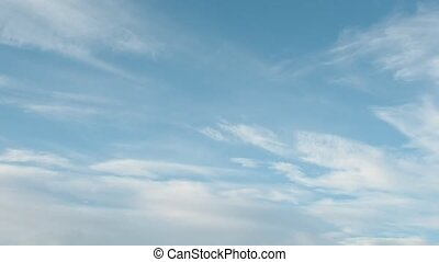 Delicate Cirrus clouds in the blue sky, approaching sunset -...