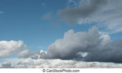 Blue sky. Beautiful Cumulus clouds flying across the sky,...