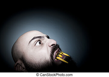 monstrous man with long teeth horror