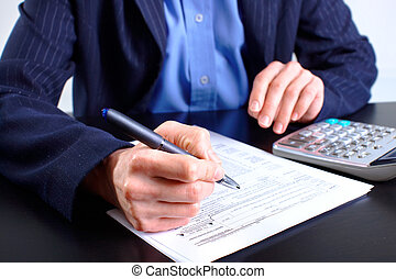 Accountant filling the forms out
