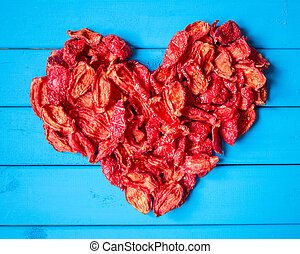 background with heartshape of sun dried tomato slices -...